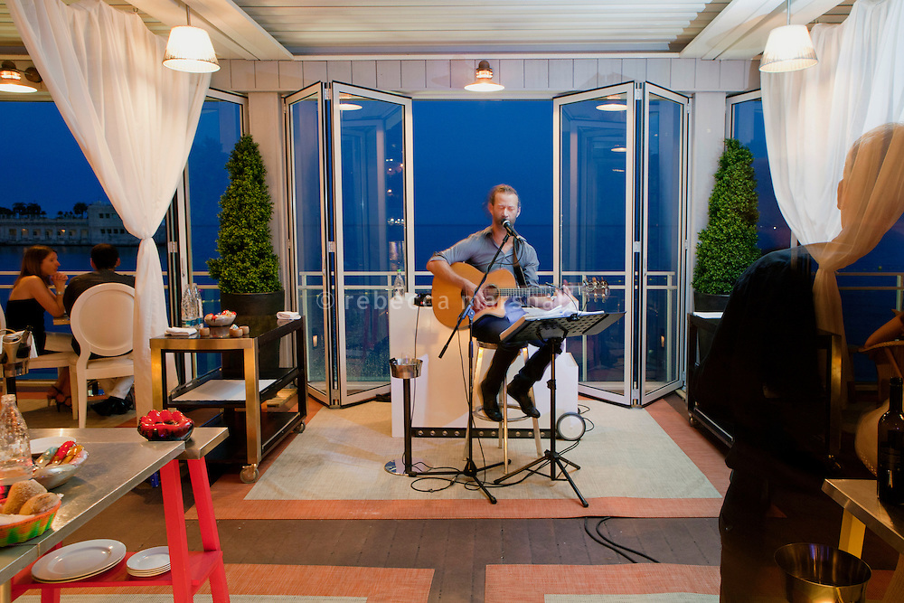 Singer-guitarist Yann Fouillet performs in restaurant La Cantine, A'Trego, Cap d'Ail, France, 5 July 2013