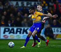 Mansfield Town's Malvind Benning shields the ball from Lincoln City's Harry Anderson<br /> <br /> Photographer Andrew Vaughan/CameraSport<br /> <br /> The EFL Sky Bet League Two - Mansfield Town v Lincoln City - Monday 18th March 2019 - Field Mill - Mansfield<br /> <br /> World Copyright © 2019 CameraSport. All rights reserved. 43 Linden Ave. Countesthorpe. Leicester. England. LE8 5PG - Tel: +44 (0) 116 277 4147 - admin@camerasport.com - www.camerasport.com