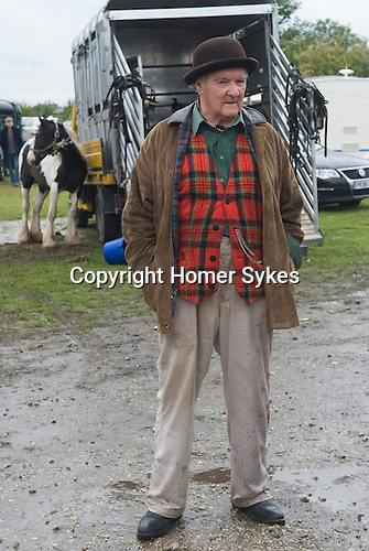 Brigg Horse Fair. Brigg Lincolnshire England 2009. Horse trader wearing Brown Derby bowler hat and tartan waistcoat.