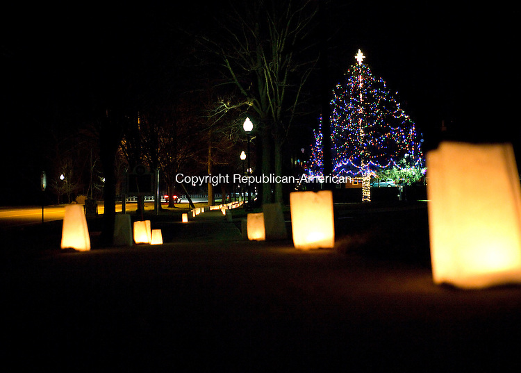 Southbury, CT- 05 December 2015-120515CM10-  Luminaries line the sidewalk as the town's Christmas Tree is displayed in Southbury on Saturday.  The town held it's 17th Annual Holiday Tree Lighting at the Memorial Green, an event sponsored by the Southbury Parks and Recreation Department.    Christopher Massa Republican-American