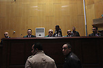 The Judge of the 'Port Said Massacre' case, speaks with witnesses during the trial of suspects in Cairo on December 23, 2014. The defendants were originally given sentences ranging from 15 years to life in prison. They were convicted of the murder of over 70 Ahly fans, nine security personnel and three officials from Al-Masry Club at a football match in Port Said in February 2012. Photo by Amr Sayed