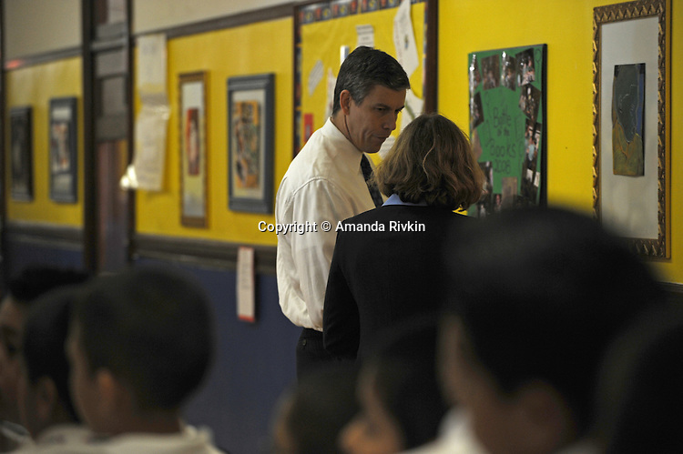 "Arne Duncan, the Chief Executive Officer of the Chicago Public Schools, CPS, stands in the hallway before a press conference for Chicago Mayor Richard M. Daley's ""Principal for a Day"" program of corporate sponsorship and volunteerism in the Chicago Public Schools at Talcott Elementary School at 1840 W. Ohio St., in Chicago, Illinois on October 17, 2008."