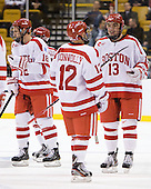 Wade Megan (BU - 18), Chris Connolly (BU - 12), Garrett Noonan (BU - 13) - The Boston University Terriers defeated the Harvard University Crimson 3-1 in the opening round of the 2012 Beanpot on Monday, February 6, 2012, at TD Garden in Boston, Massachusetts.