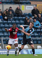 Roarie Deacon of Crawley Town holds off Stephen McGinn of Wycombe Wanderers during the Sky Bet League 2 match between Wycombe Wanderers and Crawley Town at Adams Park, High Wycombe, England on 28 December 2015. Photo by Andy Rowland / PRiME Media Images