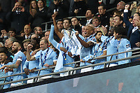 Vincent Kompany of Manchester City lifts the Capital One Cup after victory against Liverpool after the Capital One Cup match between Liverpool and Manchester City at Wembley Stadium, London, England on 28 February 2016. Photo by David Horn / PRiME Media Images.
