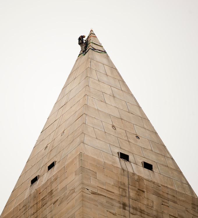 UNITED STATES - SEPTEMBER 27: A worker installs rigging at the top of the Washington Monument on Tuesday, Sept. 27, 2011, so that a team of rappelling engineers can inspect the landmark for damage caused by the 5.8 magnitude earthquake that hit the DC area in August. (Photo By Bill Clark/Roll Call)
