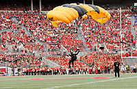 The U.S. Army Golden Knights parachute team flies into Ohio Stadium prior to the Ohio State Buckeyes NCAA football game against the Army Black Knights at Ohio Stadium in Columbus on Sept. 16, 2017. [Adam Cairns / Dispatch]