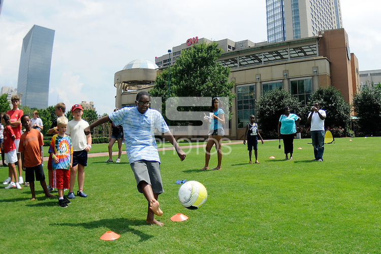 A fan kicks a soccer ball during the Women's Professional Soccer (WPS) All-Star Fan Fest at Centennial Olympic Park in Atlanta, GA, on June 28, 2010.