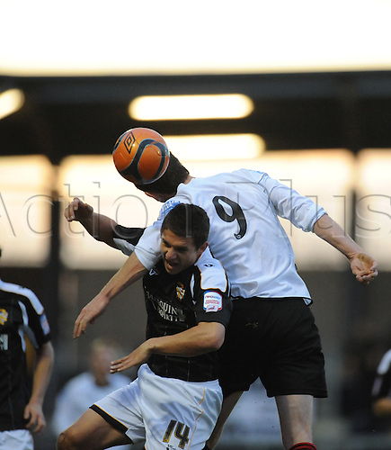 06.11.2010 FA Cup 1st Round from Princes Park,Dartford v Port Vale. Dartfords Carl Rook and Kris Taylor of Port Vale battle for the ball in their 1-1 draw