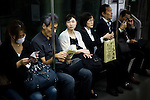 Tokyo, October 25 2011 - In the morning at on the Chuo line train, between Yoyogi and Shinjuku stations.