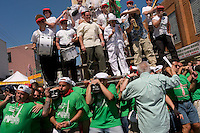 rooklyn New York - 13 July 2008 - THE DANCE OF THE GIGLIO - 120 Italian American men, adorned in the colors of the Italian Flag, carry the Giglio, and a similarly size boat, through the streets of WIlliamsburg, Brooklyn.  The Giglio and the boat meet, at the intersection of Havemeyer and North 8th Street to mark the Feast Day of fifth Century Saint Paulino, of Nola Italy. The Giglio is said to weigh 6000 pounds, is 80- feet tall, and carries a 10 piece band, a  Capo (Captain) and two priests from Our Lady of Mount Carmel Church.