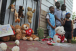 Children pose for a picture in front of Michael Jackson's boyhood home shortly after he passed away at a Los Angeles hospital outside the home at 2300 Jackson Street in Gary, Indiana on June 25, 2009.