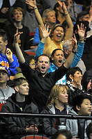 Fans celebrate in the stands during the national basketball league final between Wellington Saints and Bay Hawks at TSB Bank Arena, Wellington, New Zealand on Saturday, 5 July 2014. Photo: Dave Lintott / lintottphoto.co.nz