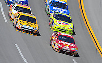 Apr 26, 2009; Talladega, AL, USA; NASCAR Sprint Cup Series driver Clint Bowyer (33) leads the field during the Aarons 499 at Talladega Superspeedway. Mandatory Credit: Mark J. Rebilas-