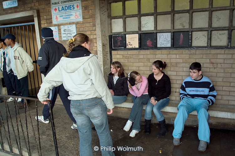 Teenagers loiter outside public toilets close to the beach at the seaside holiday resort of Cleethorpes, on the outskirts of the declining fishing port of Grimsby.