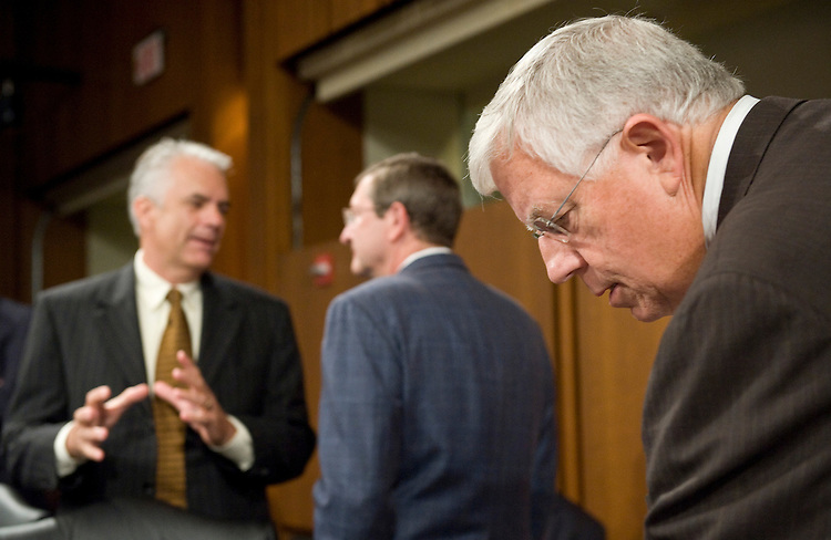 "Sen. Michael Enzi, R-Wyo., right, arrives for the Senate Finance Committee's markup of ""The America's Health Future Act"" continues on Tuesday, Sept. 29, 2009, as Sen. John Ensign, R-Nev., and Sen. Kent Conrad, D-N. Dak., talk in the background."