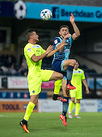 Dan Rowe of Wycombe Wanderers and Ben Dickenson of Colchester United during the Sky Bet League 2 match between Wycombe Wanderers and Colchester United at Adams Park, High Wycombe, England on 27 August 2016. Photo by Liam McAvoy.