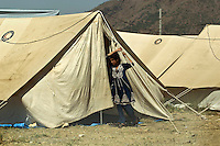 A girl in front of her tent in the Swabi Refugee camp. The camp is run by Red Cross/Red Crescent (ICRC), and currently houses around 18,000 refugees. The Pakistani government began an offensive against the Taliban in the Swat Valley in April 2009, which led to a major humanitarian crisis. Up to two million civilians were estimated to have been displaced by the fighting.