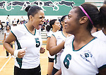 The Gazette Charles Flowers' #5 Sarah Nwokorie (left) lets out a shout for joy as teammate Tamara Leslie (right) smiles as after Charles Flowers defeated Eleanor Roosevelt for the 4A South Region title at Flowers High School in Springdale on Friday evening. Flowers won 3 games to 2.