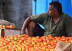 Salesman vegetables at  Devaraja Market in Mysore