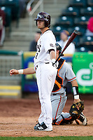 Joey Hawkins (7) of the Missouri State Bears reads the batting signals during a game against the Oklahoma State Cowboys at Hammons Field on March 6, 2012 in Springfield, Missouri. (David Welker / Four Seam Images)