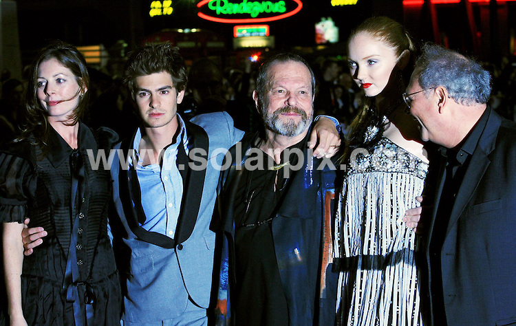 """**ALL ROUND PICTURES FROM SOLARPIX.COM**.**WORLDWIDE SYNDICATION RIGHTS**.The UK Premiere of """"The Imaginarium of Doctor Parnassus"""" at the Empire Cinema in Leicester Square, London on Tuesday 6 October 2009.This pic:  L-R Amy Gilliam, Andrew Garfield, Terry Gilliam and Lily Cole.JOB REF:  10074   LNJ     DATE:  07.10.09.**MUST CREDIT SOLARPIX.COM OR DOUBLE FEE WILL BE CHARGED**.**MUST NOTIFY SOLARPIX OF ONLINE USAGE**.**CALL US ON: +34 952 811 768 or LOW RATE FROM UK 0844 617 7637**"""