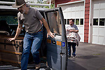Curt unloads the personal belongings of Aaron Bridgham, right, as he moves in with a new family in Vassalboro, Maine. Aaron lived with Curt for 10 years, and is the first of the residents to leave Curt's home prior to his retirement.