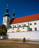 AUSTRIA, Frauenkirchen, people walk in front of the Basilica Baroque Church, Burgenland