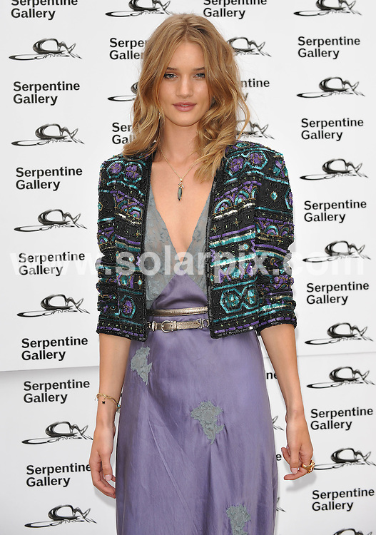 **ALL ROUND PICTURES FROM SOLARPIX.COM**.**WORLDWIDE SYNDICATION RIGHTS**.Outside arrivals at the Serpentine art gallery Summer Party 2009.  Held at the Serpentine, Hyde Park, London, UK. July 08, 2009...This pic: Rosie Huntington-Whiteley..JOB REF: 9463 SSD     DATE: 09_07_2009.**MUST CREDIT SOLARPIX.COM OR DOUBLE FEE WILL BE CHARGED**.**ONLINE USAGE FEE GBP 50.00 PER PICTURE - NOTIFICATION OF USAGE TO PHOTO @ SOLARPIX.COM**.**CALL SOLARPIX : +34 952 811 768 or LOW RATE FROM UK 0844 617 7637**