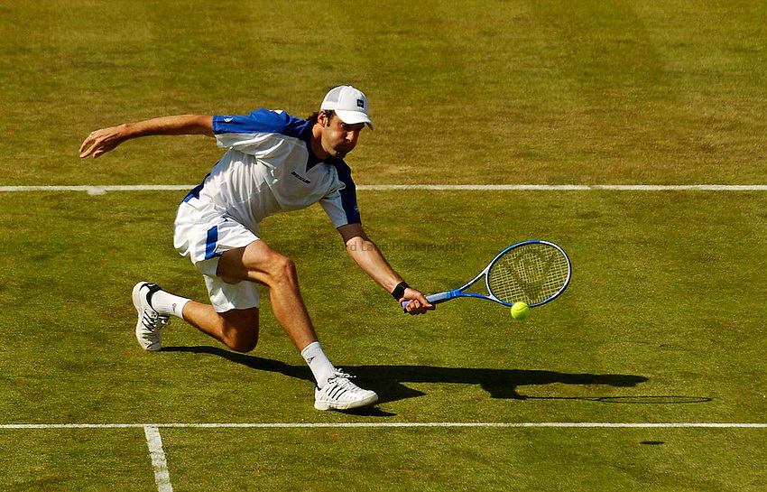Photo. Jed Wee..Stella Artois Championships. .08/06/2005..Britain's Greg Rusedski in action against Russia's Dmitry Tursunov.