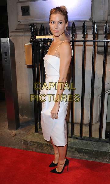 Sienna Miller <br /> The BFI Luminous Gala, London, England.<br /> 8th October 2013<br /> full length white dress side <br /> CAP/BEL<br /> &copy;Tom Belcher/Capital Pictures