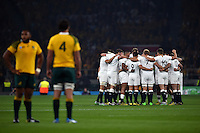 The England team huddle together prior to kick off. Rugby World Cup Pool A match between England and Australia on October 3, 2015 at Twickenham Stadium in London, England. Photo by: Patrick Khachfe / Onside Images