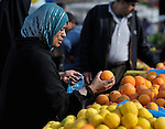 A woman shopping in the market of the Nuseirat refugee camp in the middle of the Gaza strip. While Gazans grow much of their own food, repressive restrictions on land use imposed by the Israeli military means some food has to be imported at great cost from Egypt and Israel..