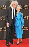 Brian May and Anita Dobson at the Olivier Awards 2018, Royal Albert Hall, Kensington Gore, London, England, UK, on Sunday 08 April 2018.<br /> CAP/CAN<br /> &copy;CAN/Capital Pictures<br /> CAP/CAN<br /> &copy;CAN/Capital Pictures