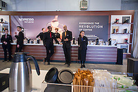 "Baristas lined up ready to serve  Nespresso brand single-shot coffee at a promotional event in New York on Thursday, February 20, 2014. The single-cup machines use Nespresso ""capsules"" which contain a single serving of coffee. They are in direct competition with Green Mountain Roasters, using Keurig pods,  which controls a 90% share of the US market. (© Richard B. Levine)"
