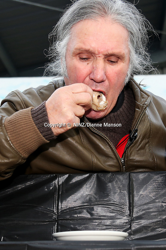 A competitor in the oyster eating competition during the Bluff Oyster and Food Festival, Bluff, New Zealand, Saturday, May 21, 2016. Credit: Dianne Manson
