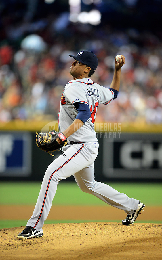 Apr. 22, 2012; Phoenix, AZ, USA; Atlanta Braves pitcher Randall Delgado throws a pitch in the first inning against the Arizona Diamondbacks at Chase Field.  Mandatory Credit: Mark J. Rebilas-