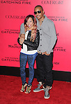 LOS ANGELES, CA - NOVEMBER 18: T.I. and Tiny arrives at   THE HUNGER GAMES: CATCHING FIRE L.A. Premiere held at Nokia Live  in Los Angeles, California on November 18,2012                                                                               © 2013  Hollywood Press Agency