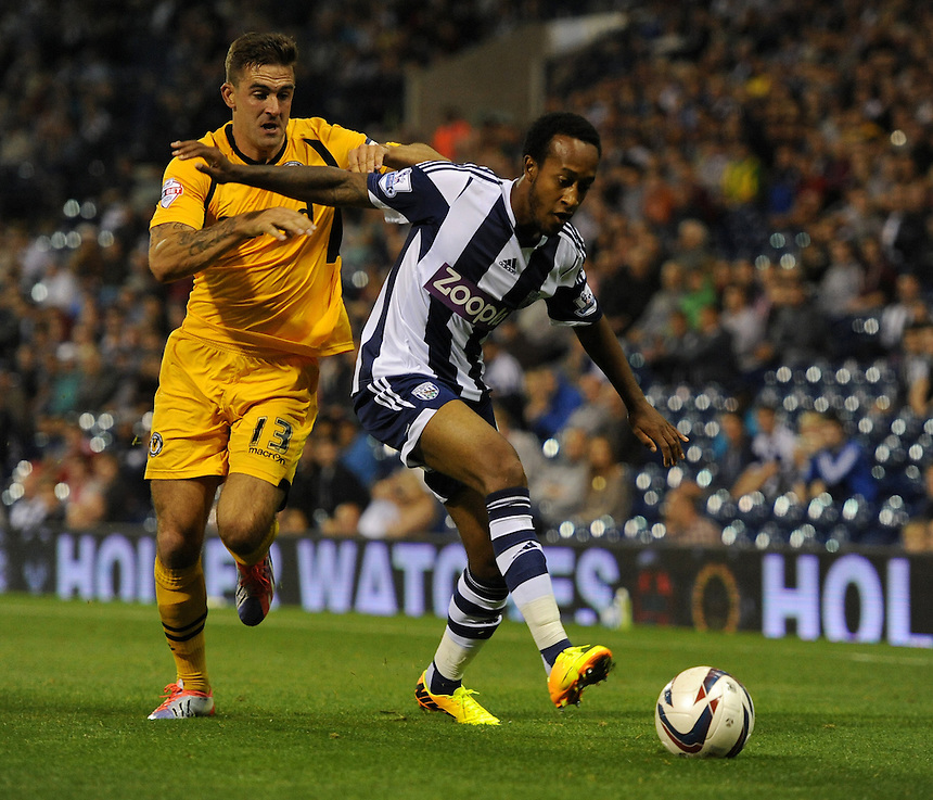 Newport County's Andy Sandell battles with West Bromwich Albion's Cameron Gayle<br /> <br /> Photo by Ashley Crowden/CameraSport<br /> <br /> Football - Capital One Cup Second Round - West Bromwich Albion v Newport County - Tuesday 27th August 2013 - The Hawthorns - West Bromwich<br />  <br /> &copy; CameraSport - 43 Linden Ave. Countesthorpe. Leicester. England. LE8 5PG - Tel: +44 (0) 116 277 4147 - admin@camerasport.com - www.camerasport.com
