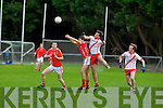 An Ghaeltacht's Brian O Murchu and East Kerry's Liam Kearney junp for the ball in the minor County championship final at Killorglin on Saturday.