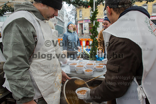 Krishna charity activists distribute free food to people in need in Budapest, Hungary on December 25, 2012. ATTILA VOLGYI