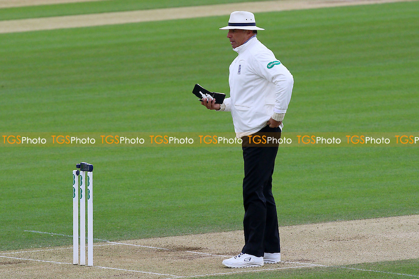 Umpire David Millns checks the light with a meter during Essex CCC vs Northamptonshire CCC, Specsavers County Championship Division 2 Cricket at the Essex County Ground on 25th April 2016