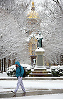 December 8, 2011; A student walks past the Fr. Sorin Statue. Photo by Barbara Johnston/University of Notre Dame.