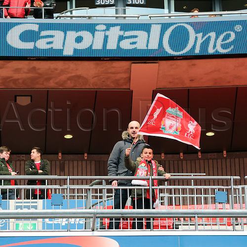 28.02.2016. Wembley Stadium, London, England. Capital One Cup Final. Manchester City versus Liverpool.  An excited Liverpool fan waves his flag inside Wembley Stadium hoping for a victory