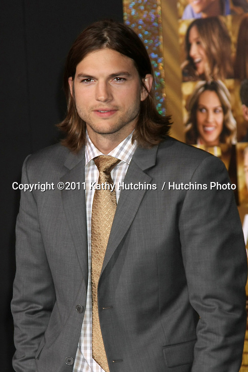 "LOS ANGELES - DEC 5:  Ashton Kutcher arrives at the ""New Year's Eve"" World Premiere at Graumans Chinese Theater on December 5, 2011 in Los Angeles, CA"