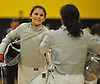 Stephanie Miller of Commack, left, shakes hands with Gabby Reyes of Brentwood after their sabre bout in a girls fencing match at Commack High School on Friday, Dec. 2, 2016.