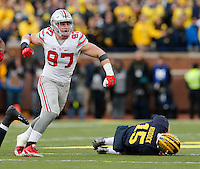 Ohio State Buckeyes defensive lineman Joey Bosa (97) celebrates sacking Michigan Wolverines quarterback Jake Rudock (15) during the fourth quarter of the NCAA football game at Michigan Stadium in Ann Arbor on Nov. 28, 2015. Ohio State won 42-13. (Adam Cairns / The Columbus Dispatch)