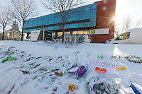 Signs, flowers, and trucks from a cleaning company are seen outside the Grande Mosquée de Quebec (Centre Culturel Islamique de Quebec as , Thursday February 2, 2017. Sunday January 29, a shooter left six worshippers dead at this Quebec city mosque.