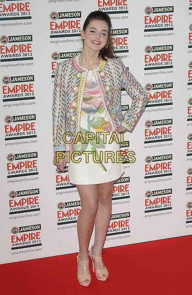 Celine Buckens.The Jameson Empire Film Awards 2012, Grosvenor House Hotel, Park Lane, London, England..March 25th, 2012.full length white pink green rose floral print dress jacket yellow hand on hip.CAP/CAN.©Can Nguyen/Capital Pictures.