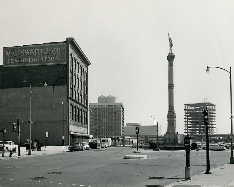 1963 October 09..Redevelopment...Downtown South (R-9)..One Commercial Place.Confederate Monument.WG Swartz Co. Building.Looking East on Main Street...NEG#.NRHA# 1027-B..